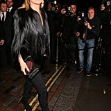 Kate Moss looked like she was stepping out of a fashion ad outside the Melissa flagship store launch party in London on Thursday.