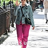 Lena Dunham waved on Tuesday during shoots for season three of her hit show Girls in NYC.
