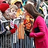 She accepted a bouquet from a little girl in glasses outside the Coventry Cathedral in January 2018.