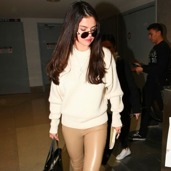 Selena Gomez Wearing White Sweater and Leather Leggings