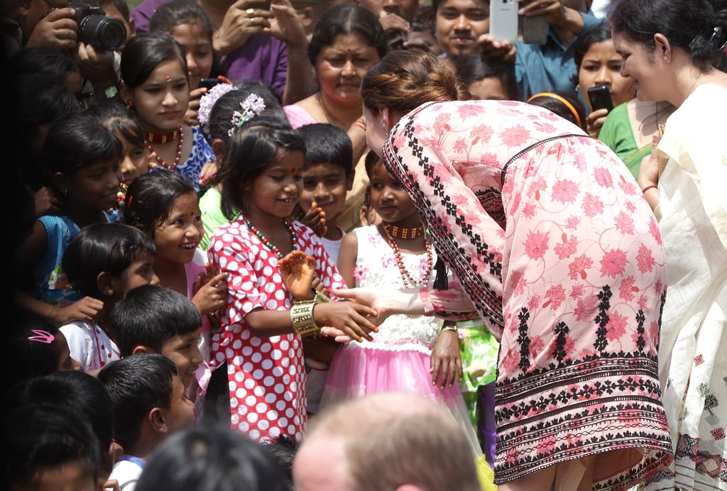 Kate greeted a group of little girls while visiting an agricultural village in Guwahati, India in April 2016.