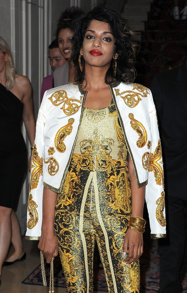 M.I.A. posed at the Versace show for Paris Fashion Week.