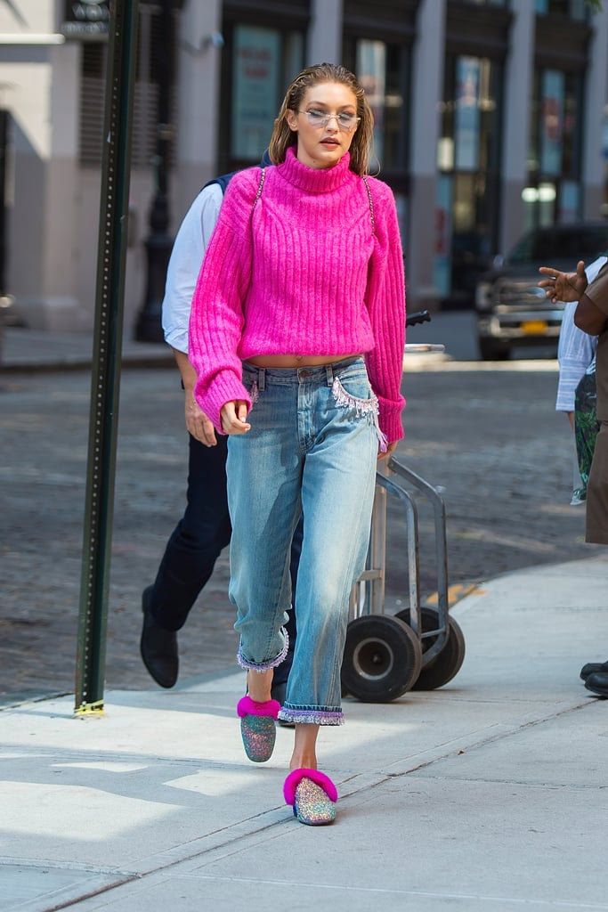 The model was going for it with all pink vibes in her bright magenta sweater from 3.1 Phillip Lim and Christian Louboutin fuzzy mules on Sept. 11. Even her Marc Jacobs jeans had pink and purple trimmings.