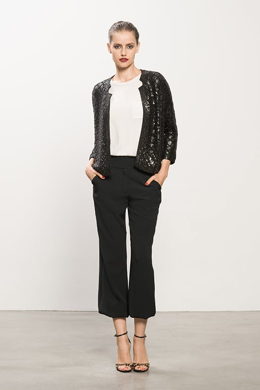 Sequin Black Cardigan ($750), Cashmere Cream Tee ($295), Crepe Black Elastic Bottom Pant ($595), Wild Night Leopard Pony Sandal ($750) Photo courtesy of Tamara Mellon