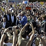 Even in a sea of people, politicians, like then-President George W. Bush, can pick out the baby, as he did during a 2004 stop in Chanhassen, MN.