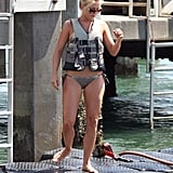 In July 2011, Julianne wore bikini bottoms and a life vest in Miami.