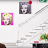 The pop art placed along the wall above Kylie's staircase offsets nicely with the blank white canvas surrounding it.