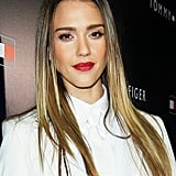 Pink shadow and red lipstick made for a winning combo at the 2013 Tommy Hilfiger flagship opening.