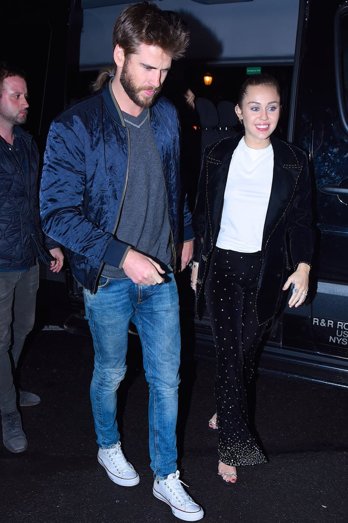 Liam Hemsworth and Miley Cyrus took a big bite of the Big Apple over the weekend, and the result was incredibly sweet. After sharing the screen during a hilarious skit on Saturday Night Live, the couple continued the fun by attending an afterparty for the show at Sarabeth's restaurant in NYC. Aside from sporting bands on that finger, the pair also shared a cute moment as Liam took Miley's hand and helped her out of the car like a true gentleman. While the two have yet to comment on marriage rumors, one thing is for sure: Liam really is Miley's Prince Charming.