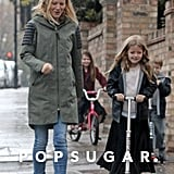 Gwyneth Paltrow in London with kids Apple Martin and Moses Martin.