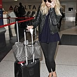 Styling skinny jeans with a cool leather jacket and pointed-toe flats in 2015.