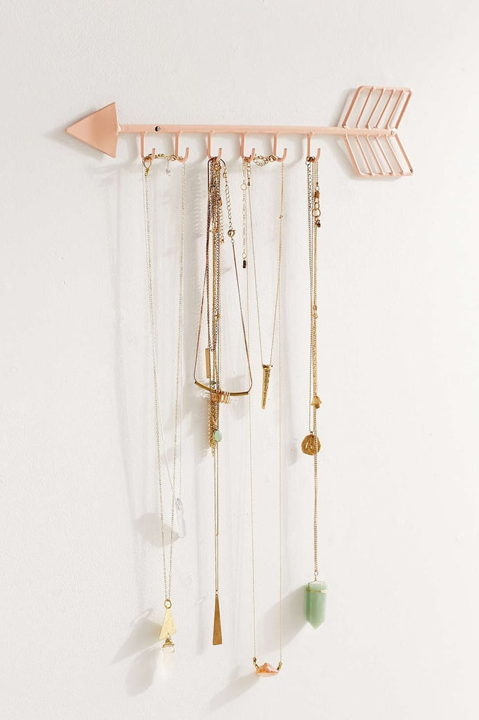 There will be no more coats or purses on the ground with this pretty gold wall hook ($19).