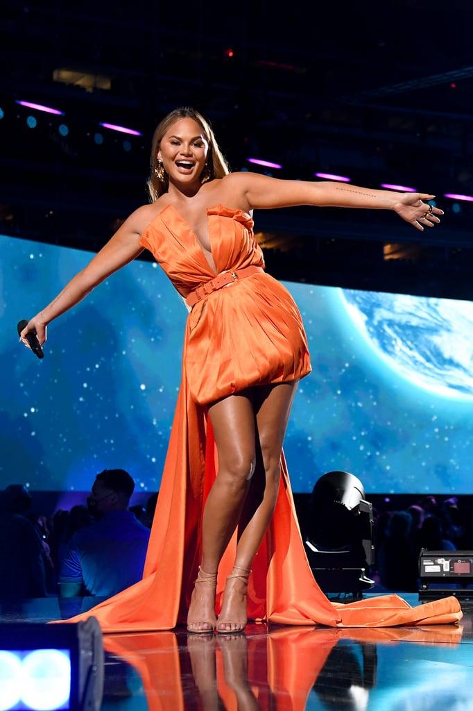 See Chrissy Teigen's Orange Dress at Global Citizen Vax Live