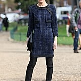 A tweedy midnight blue dress right over slim black pants made this a chic snap.