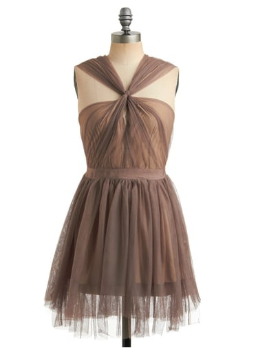 We love the ultra-girlie tulle and the great neckline.  ModCloth Light of the Silvery Plume Dress (approx $87)