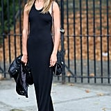 All black and all cool, thanks to a chain-strap bag and a pair of gladiator flats to amp up a basic maxi dress. Source: Greg Kessler