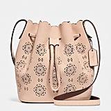 Coach Floral Cutout Bucket Bag