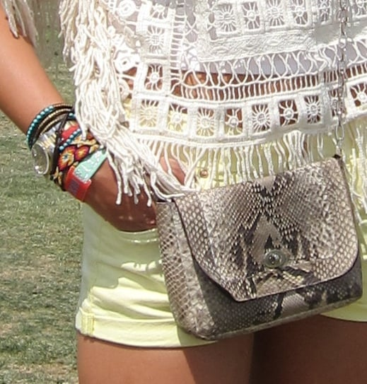 We love the textural intrigue of this snake-print cross-body bag and the awesome wrist full of bracelets.