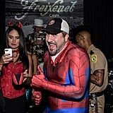 Joey Fatone's baseball cap was part of his Spiderman costume.