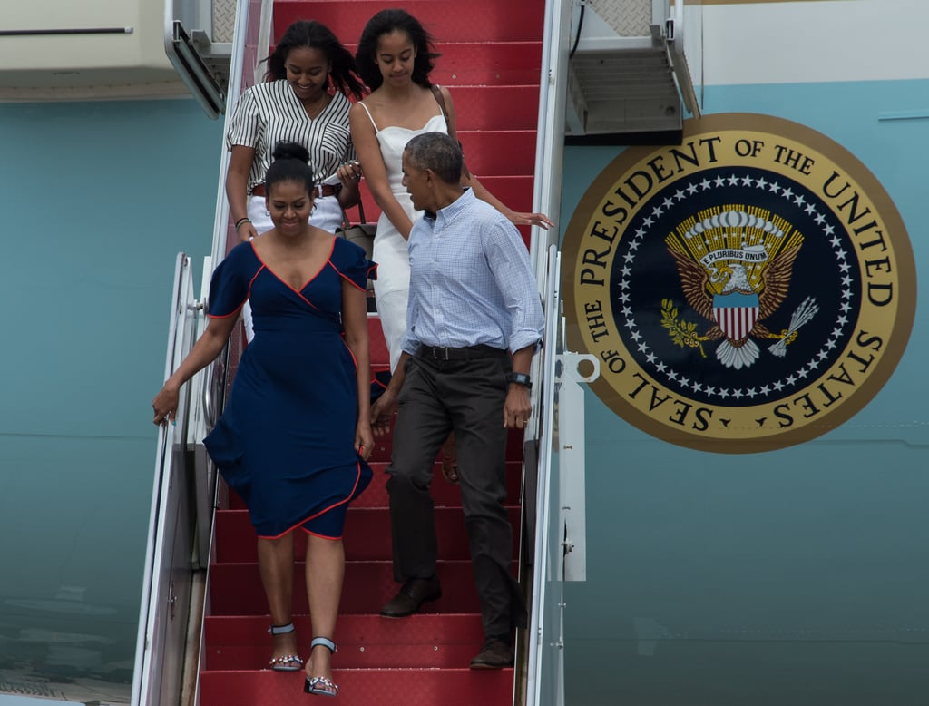 Michelle wearing a navy Tory Burch dress with orange piping on the way to Martha's Vineyard.