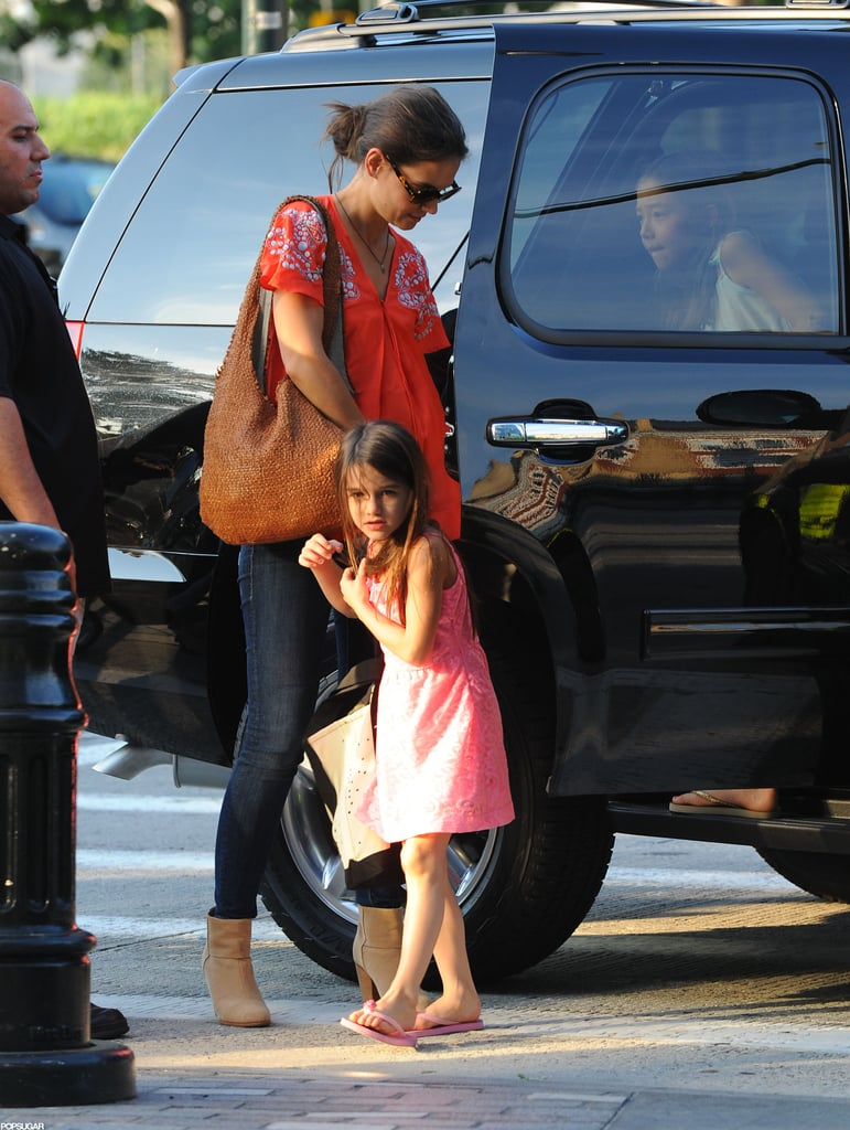 Katie Holmes kept an eye on daughter Suri Cruise yesterday during an outing to Chelsea Piers in NYC. The athletics center is one of Suri's favorite spots, and the girls go frequently for the little one's gymnastics class. Katie and Suri are establishing themselves as NYC residents in the wake of Katie and Tom Cruise's divorce. Katie's even making friends with other moms in their new apartment building. Tom, who was in Iceland when Katie asked to separate, has since returned to the US. He's been in California wrapping up work on his latest movie, Oblivion. Under the terms of Tom and Katie's split, he's granted visitation rights with Suri. Reports suggest that Tom will see Suri soon, possibly even this weekend.