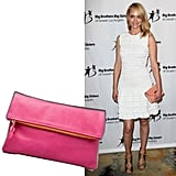 While Amber Valletta's ruched white cocktail dress is a sweet evening LWD, a vibrant foldover clutch — in place of the peach-toned version she chose — will instantly introduce a new (colorful) dynamic. Plus, the hue alone is a conversation starter.
