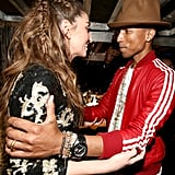 Pharrell and Sara Bareilles embraced backstage.
