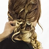 Scrunch the loose braid up to your scalp and secure it with bobby pins. Once you spritz all over with your favorite hair spray, like Kenra Professional Design Spray 9 ($17), you're done! Go out and show off that awesome plait.