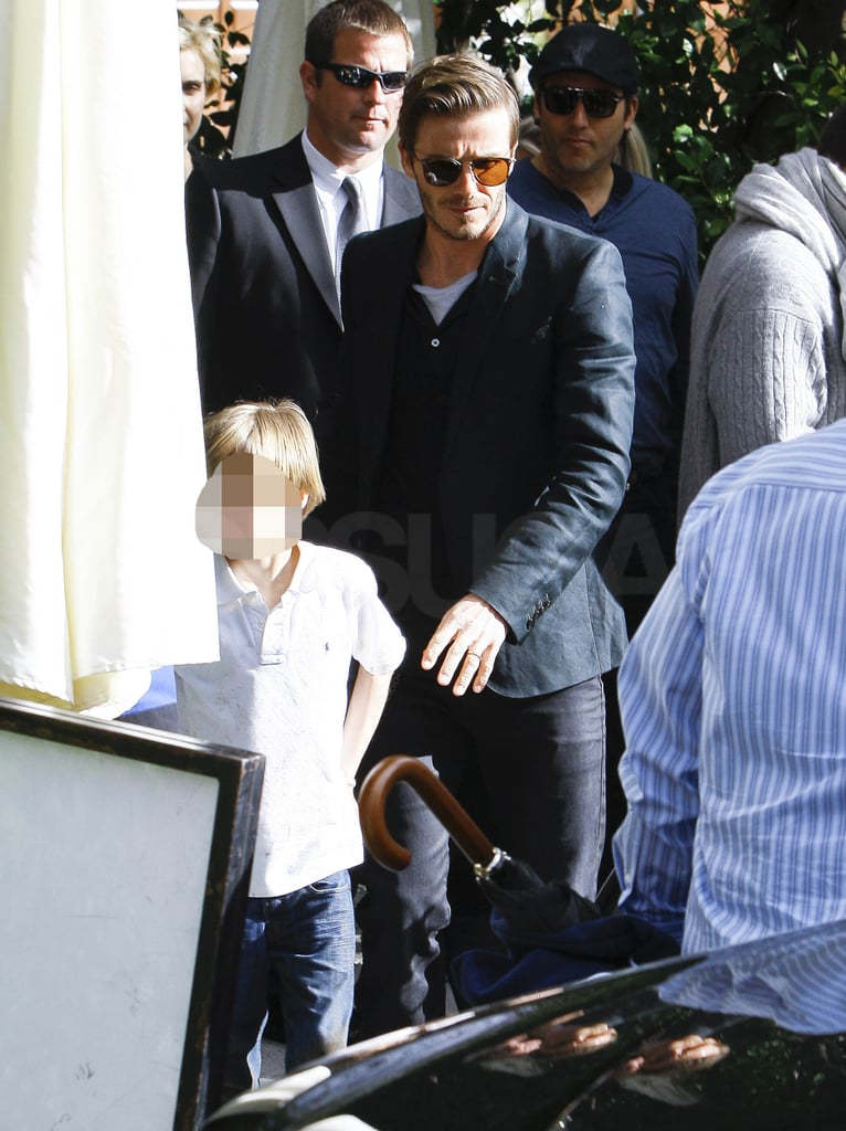David and Victoria Beckham were out in Beverly Hills yesterday as they attended a pre-Oscar party. David looked smart in his jacket, covering up his new Jesus and angels tattoo while pregnant Victoria wore some gorgeous high heeled boots and a bottle green quilted leather jacket. They were accompanied by their kids at the party, where they mingled with celebs including Ellen and Portia DeGeneres, though it's not been all play since they got back to California, as David's also been training with LA Galaxy.