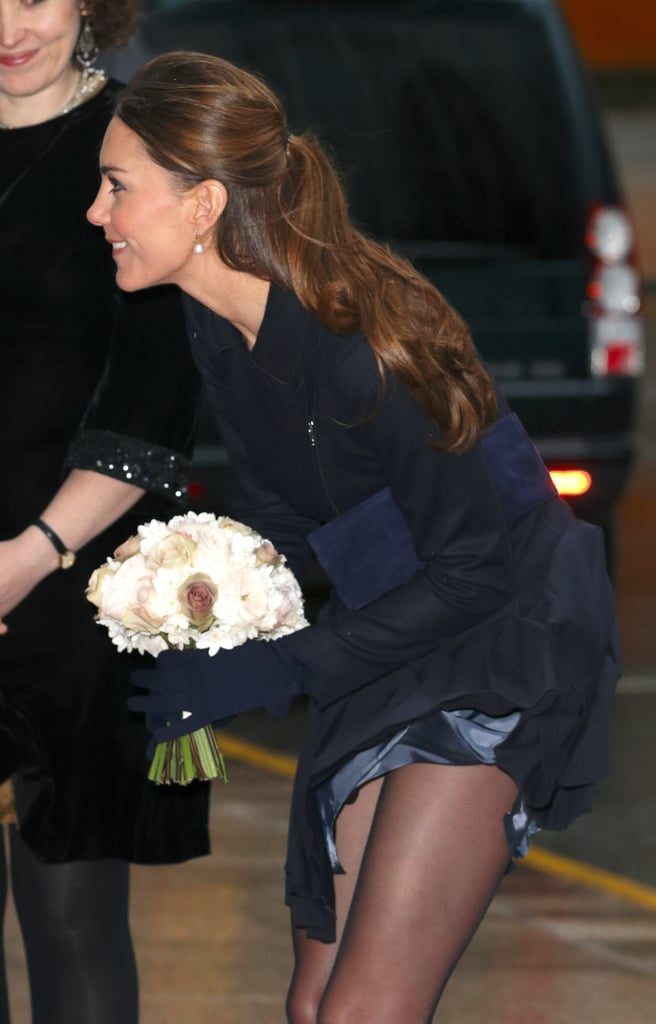 Kate attended a charity event in London back in November 2013, and her navy Orla Kiely skirt nearly got the better of her.