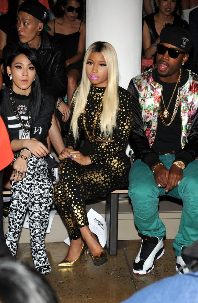 Nicki Minaj took the Jeremy Scott front row in a black and gold-dotted jumpsuit and matching gold metallic pumps.