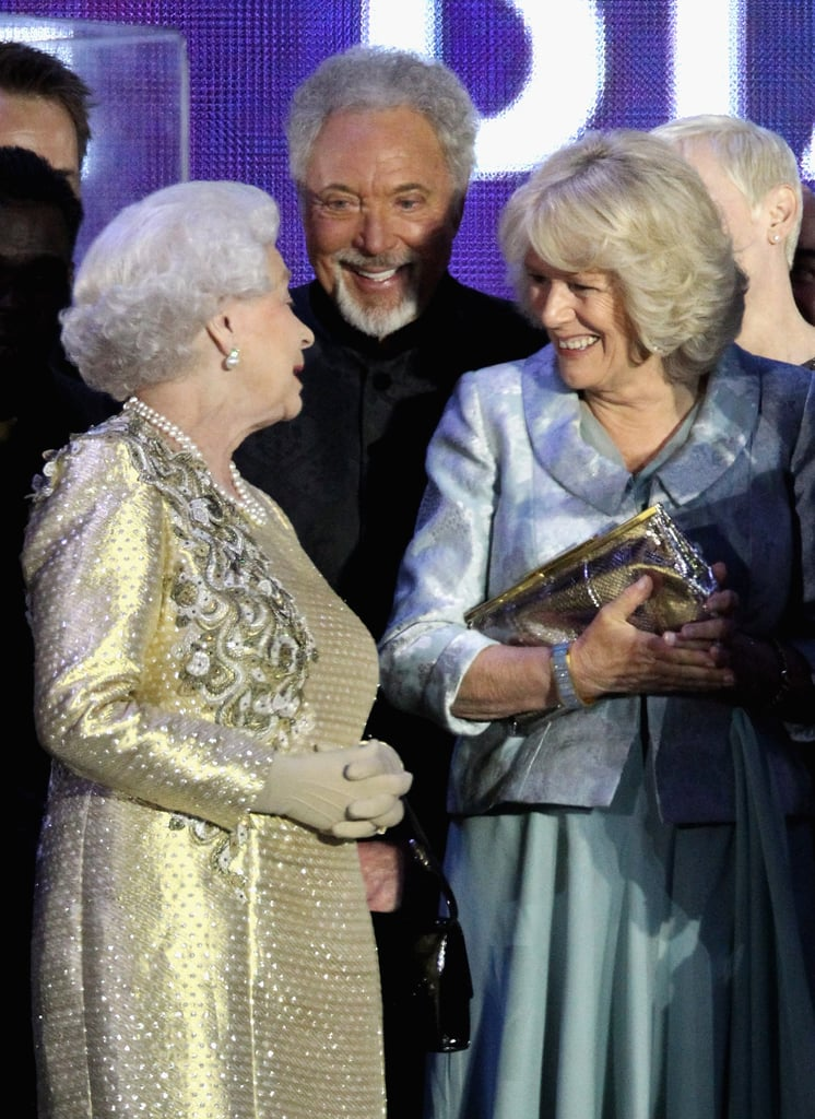 The queen laughed with Camilla at the Diamond Jubilee Concert at Buckingham Palace.