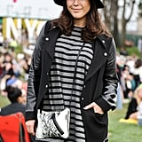 This festivalgoer caught our eye in a striped Gap dress and sporty-cool letterman jacket.