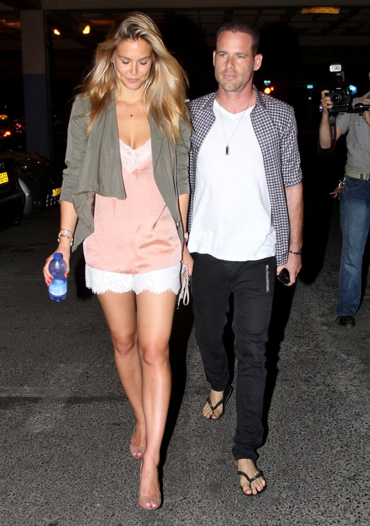 Bar Refaeli kept close to her new guy David Fisher last night as they left a nightclub in Tel Aviv. Bar and David have been traveling together this month and were also seen at a Paris airport over the Fourth of July weekend. Bar tweeted about doing Pilates this morning and has also been enjoying the view in her native country while she and David enjoy time there. He's the first guy Bar has stepped out with publicly since her breakup from Leonardo DiCaprio made news in May. Meanwhile, Leo is in the midst of a Summer romance with Blake Lively. The pair were last spotted together on a weekend getaway to Carmel, CA, a few weeks ago.