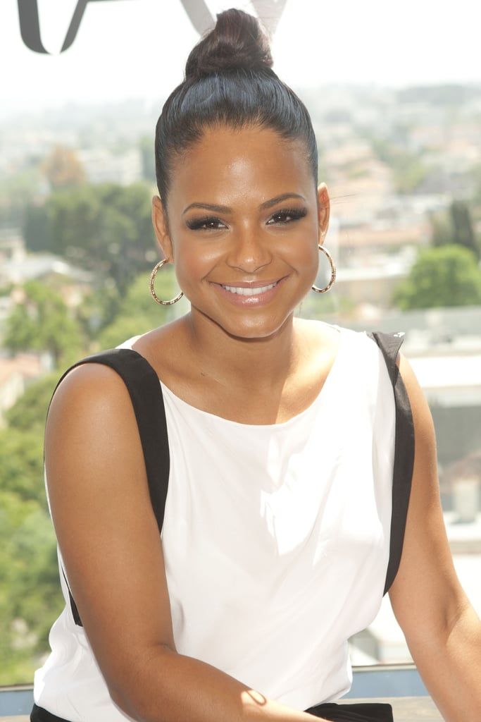 Christina Milian's knot has a few ends sticking out of her bun, creating a cool, breezy effect.