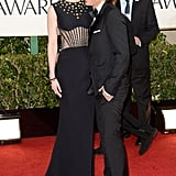 Cute couple Nicole Kidman and Keith Urban cuddled up on the carpet.