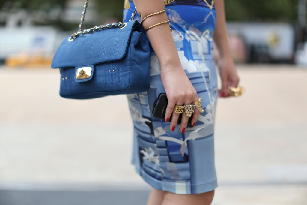 A quilted ladylike satchel picked up the blues in this print — we're also gushing over those amazing cocktail rings, one for every finger.