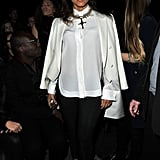 Alicia Keys kept it chic and simple, but chose a opulent gold cross necklace for Givenchy.