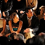 Jessica Alba and her husband Cash Warren kept their eyes peeled on the fashion coming down the runway.