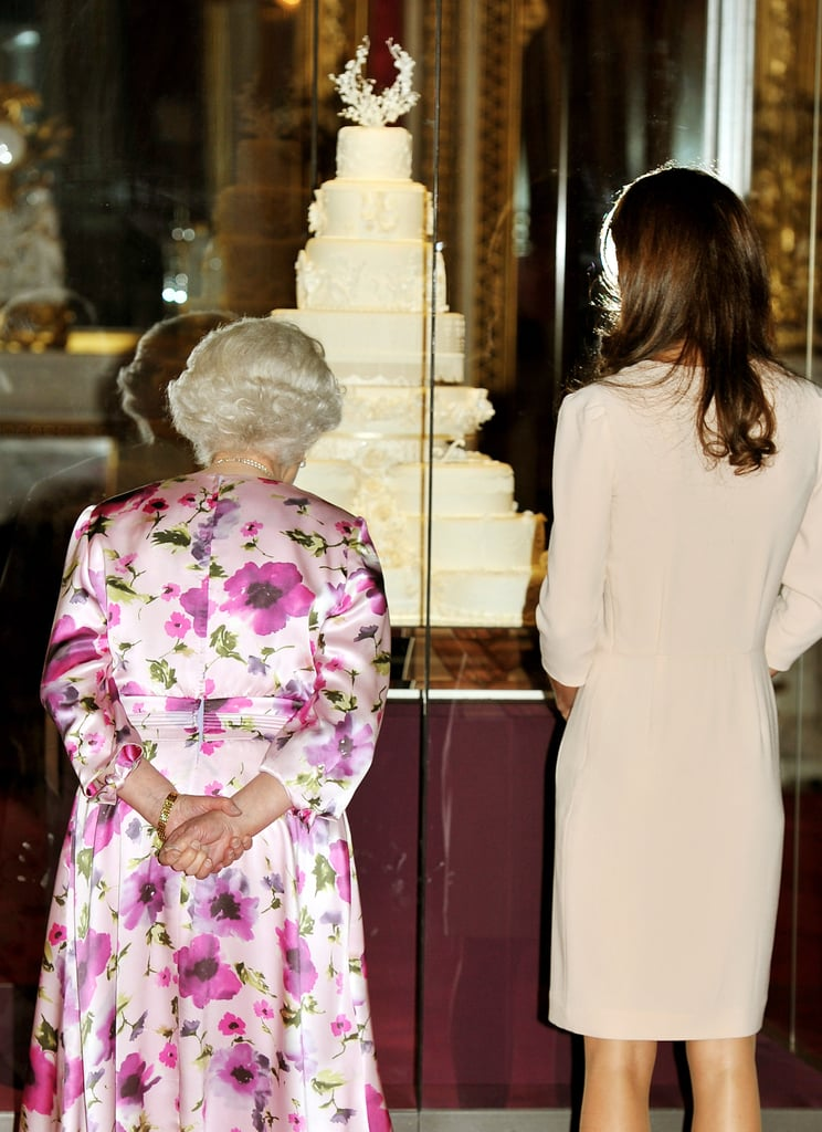 Kate Middleton viewing her wedding cake with Queen Elizabeth.
