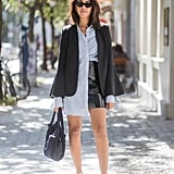 Execute the half-tuck when you let one side of your button-down hang loose. Add polish with a blazer on top.