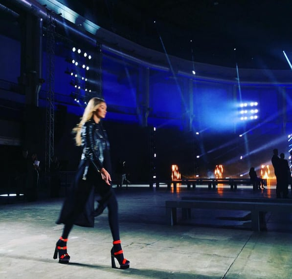 Gigi practised for the Versace show in her leather jacket and platform pumps. She shared this rehearsal shot on Instagram.