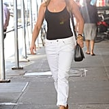Jen generally reserves white denim for Summer, and she styled a pair with a black cami and tan heels in June 2016.