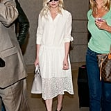 Kirsten Dunst worked a breezy white dress for the prettiest kind of travel style.