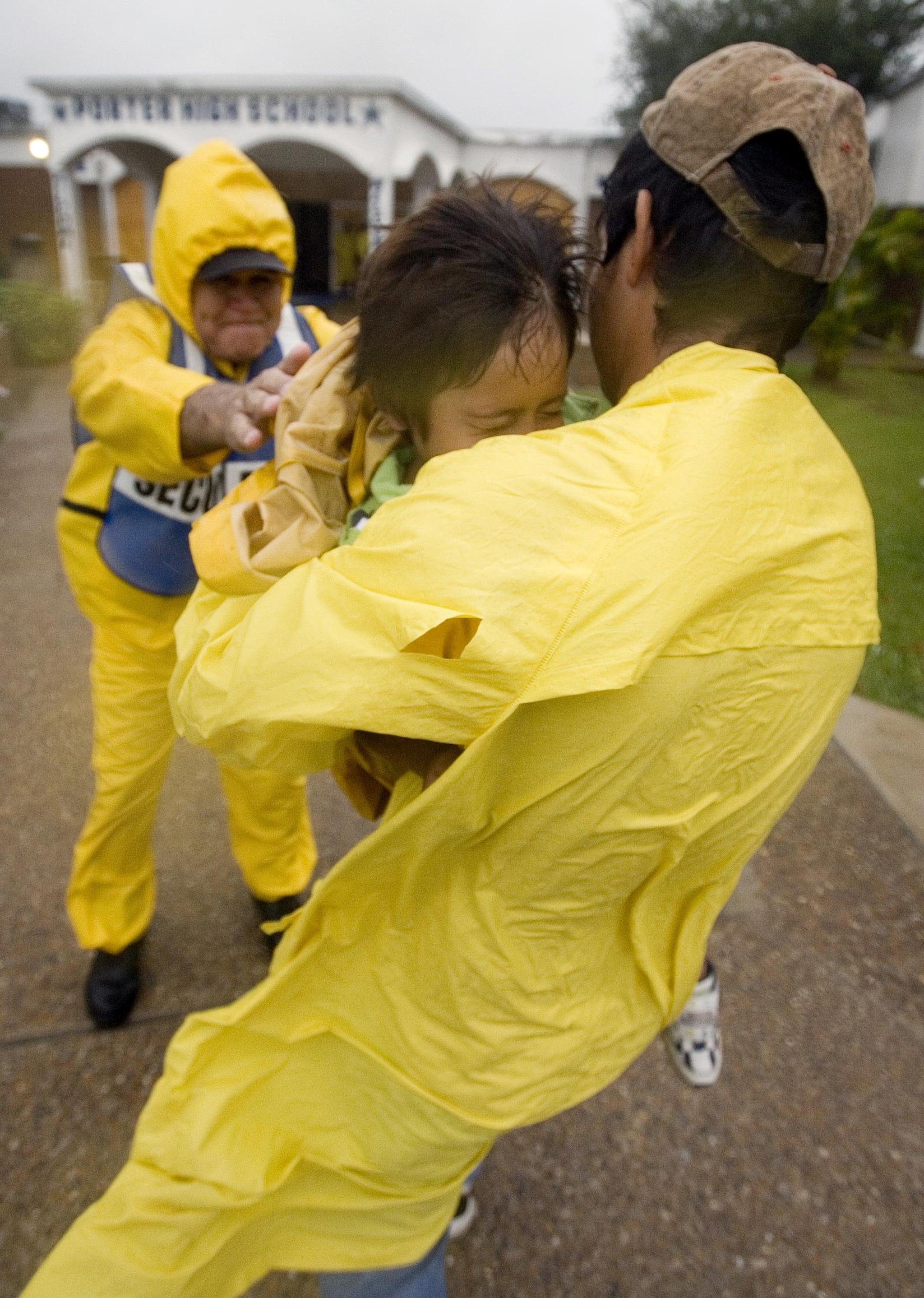 Brownsville Independent School District officer helps evacuees.