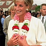 She received a traditional garland when she arrived at the Shri Swaminarayan Mandir Hindu Temple in London in June 1997.