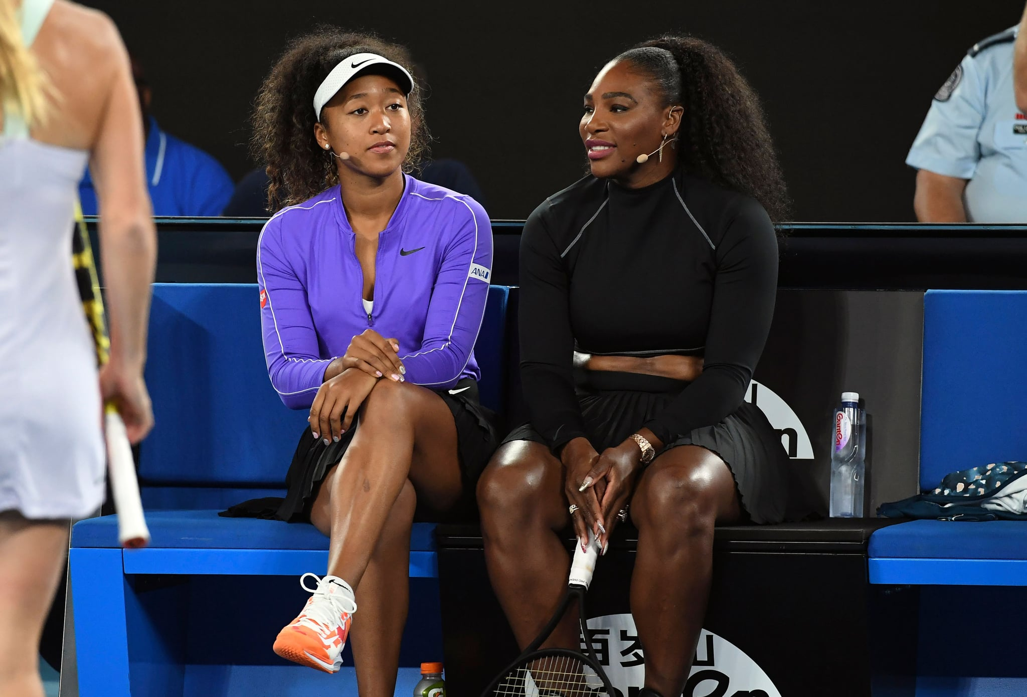 Naomi Osaka of Japan (L) and Serena Williams of the US (R) share a lighter moment as they and other top players play in the Rally for Relief charity tennis match in support of the victims of the Australian bushfires, in Melbourne of January 15, 2020, ahead of the Australian Open tennis tournament. (Photo by WILLIAM WEST / AFP) / -- IMAGE RESTRICTED TO EDITORIAL USE - STRICTLY NO COMMERCIAL USE -- (Photo by WILLIAM WEST/AFP via Getty Images)