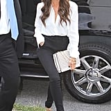 Victoria Beckham wore a white button-down.