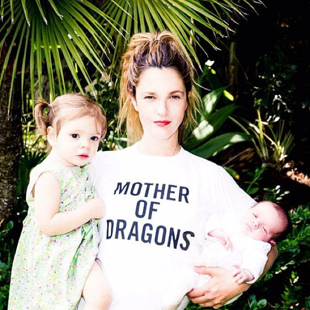 Drew Barrymore has been a Hollywood mainstay since she was a baby — and has seemed to live about a million lives since then — which is why it's so heartwarming to see her settle into the role of wife and mother. Drew married art adviser Will Kopelman in June 2012, three months before the couple welcomed their first daughter, Olive. Their second baby girl, Frankie, was born in April 2014, and the little ones quickly started to bear a resemblance to their famous mum — seriously, Olive is almost identical to a young Drew in her E.T. the Extra-Terrestrial days. Though Drew hasn't given us a ton of glimpses of her girls, we've gotten a few peeks at Frankie and Olive on social media, at charity events, and in People magazine. We've rounded up some of Drew's most adorable moments with her kids; keep reading to see them all now, then check out more famous families you should follow on Instagram.