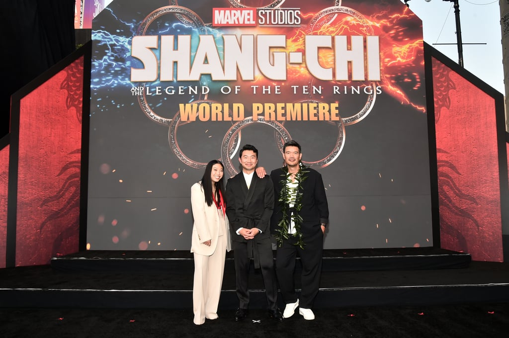 """The cast of Shang-Chi and the Legend of the Ten Rings took over Hollywood Boulevard for the film's world premiere. On Monday night, stars Simu Liu, Awkwafina, Fala Chen, Ronny Chieng, Dallas Liu, Benedict Wong, and more joined together at El Capitan Theatre in LA as they ushered in the exciting new era of the MCU. The film is a historic moment as it marks Marvel's first Asian-led superhero movie.  """"It's such an incredible honor,"""" Simu told Variety about starring in the film. """"I hope that it's not the last, because we've been celebrating a lot of firsts in our community — when Crazy Rich Asians came out three years ago we celebrated that as the first studio movie with a predominantly Asian cast in almost 25 years — and I'm just looking forward to the moment where we no longer celebrate firsts, we're celebrating seconds, and thirds, and fourths, and fifths.""""  The premiere comes after Disney CEO Bob Chapek made headlines for saying that the film was an """"interesting experiment."""" Shortly after, Simu seemingly reacted on social media, writing, """"We are not an 'interesting experiment. We are the underdog; the underestimated. We are the ceiling-breakers. We are the celebration of culture and joy that will persevere after an embattled year. We are the surprise. I'm fired the f**k up to make history on September 3rd; JOIN US."""" Marvel president Kevin Feige later addressed the controversy at the premiere saying that it was """"a misunderstanding."""" """"The proof is in the movie and we swing for the fences as we always do. With the amount of creative energy we put in and the budget, there's no expense spared to bring this origin story to the screen."""" Regardless of what Bob may have meant with his comments, Shang-Chi is a historic moment not only for the MCU but for APIA representation on screen. See more pictures from the premiere ahead.      Related:                                                                                                                                Dragons, D"""